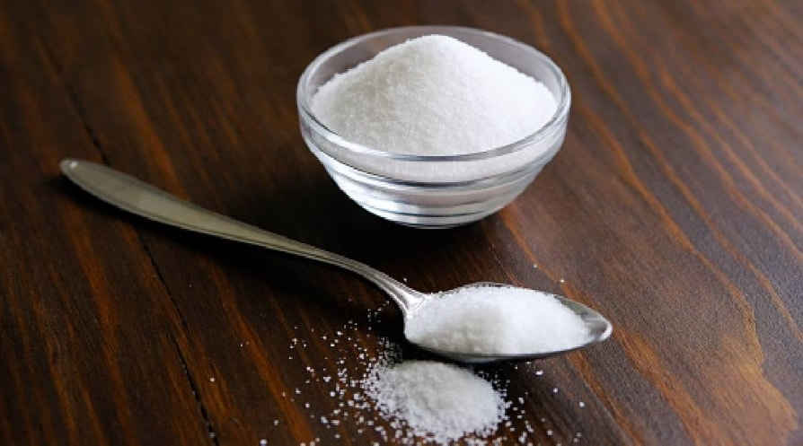 Natural seasoning, organic, sea, small and large, white salt in a spoon, in a Cup, in a salt shaker, poured on a wooden table. The concept of cooking, healthy eating, cosmetology.